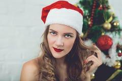 Pretty girl Santa stock photo