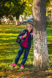 Pretty girl of school age in the autumn park. Royalty Free Stock Image