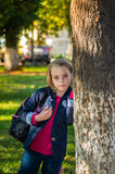 Pretty girl of school age in the autumn park. Royalty Free Stock Photography