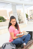 Pretty Girl at School Reading Royalty Free Stock Image