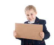 Pretty girl in school uniform holding cardboard in hands, isolated white background Royalty Free Stock Image