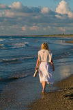Pretty girl and the sea. Attractive blond girl at the seaside Royalty Free Stock Images