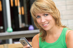 Pretty girl sending text messages stock photography