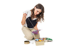 Pretty girl sewing Stock Image
