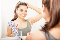 Pretty girl shaving her armpit Royalty Free Stock Image