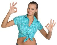Pretty girl in shirt showing ok hand signs. Full Stock Images