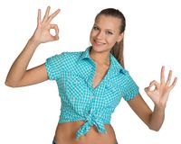 Pretty girl in shirt showing ok hand signs. Full Stock Photography
