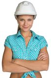 Pretty girl in shirt and white helmet standing Royalty Free Stock Photography