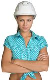 Pretty girl in shirt and white helmet standing Royalty Free Stock Photos