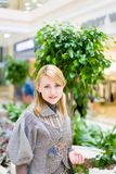 Pretty girl in shop. Look at canera Royalty Free Stock Photos
