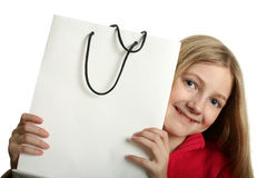 Pretty Girl with Shopping Bag. Pretty blond girl with copy space sopping bag isolated on white stock photography