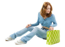 Pretty girl with a shopping bag royalty free stock photos