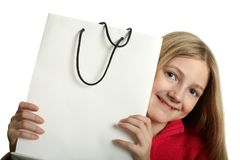 Pretty Girl with Shopping Bag. Pretty blond girl with copy space sopping bag isolated on white royalty free stock photo