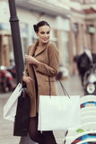 Pretty girl with shopping bag smiling Royalty Free Stock Photo