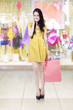 Pretty girl with shopping bags at mall Stock Photography