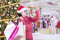 Pretty girl shopping Christmas gifts in the mall Stock Photo