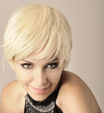 Pretty girl with short blond hair royalty free stock images