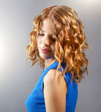 Pretty girl with short curly hair. On light background Stock Photography