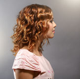 Pretty girl with short curly hair Stock Images