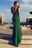 Pretty girl with short red hair in luxurious green dress Stock Photo