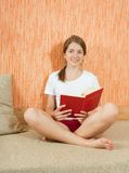 Pretty  girl in shorts  reading Royalty Free Stock Photo