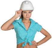 Pretty girl in shorts, shirt holding white helmet. Pretty girl in shorts, shirt holding helmet. Isolated over white background Stock Photos
