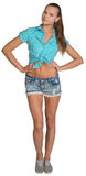 Pretty girl in shorts and shirt standing with. Hands on hips. Full length. Isolated over white background Royalty Free Stock Photos