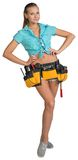 Pretty girl in shorts, shirt and tool belt with. Tools standing with hands on hip. Full length. Isolated over white background Royalty Free Stock Photos