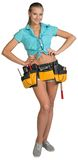 Pretty girl in shorts, shirt and tool belt with. Tools standing with hands on hip. Full length. Isolated over white background Stock Images