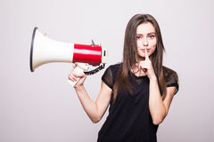 Pretty girl shouting into megaphone on copy space Royalty Free Stock Photography