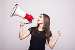 Pretty girl shouting into megaphone on copy space Royalty Free Stock Photo