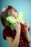 Pretty girl showing butterfly toy Stock Photo