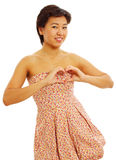 Pretty girl showing heart sign Stock Photos