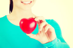 Pretty girl showing red heart Royalty Free Stock Photography