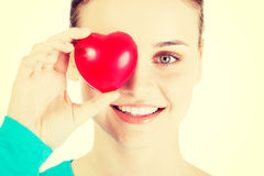 Pretty girl showing red heart Royalty Free Stock Images