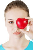 Pretty girl showing red heart Royalty Free Stock Image