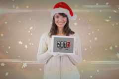 Pretty girl showing tablet with 2017 on it Stock Photography