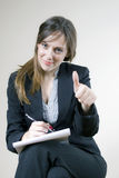 Pretty girl showing thumbs up in the office Royalty Free Stock Photos