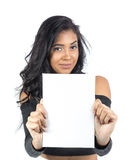 Pretty girl is showing white blank card. Young woman is showing white blank card. She is black and is smiling. Isolated white background Stock Image