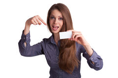 Pretty girl shows a business card. Pretty young girl shows a business card Royalty Free Stock Photos
