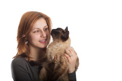 Pretty girl and Siamese cat. On a white background isolated Stock Photography