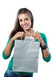 Pretty girl with silvered bag shopping. On a over white background stock image