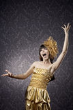 Pretty girl singing in the glamorous background Royalty Free Stock Photo