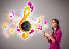 Pretty girl singing and listening to music Royalty Free Stock Image