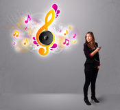 Pretty girl singing and listening to music with musical notes Stock Photo