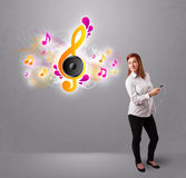 Pretty girl singing and listening to music Royalty Free Stock Photography