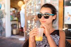 Pretty girl sipping Royalty Free Stock Images