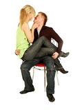 Pretty girl sits on guy's knees Stock Image