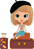 Pretty girl sits on a suitcase Royalty Free Stock Images