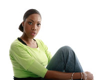 Pretty girl sitting. Woman with a beautiful complexion Stock Images